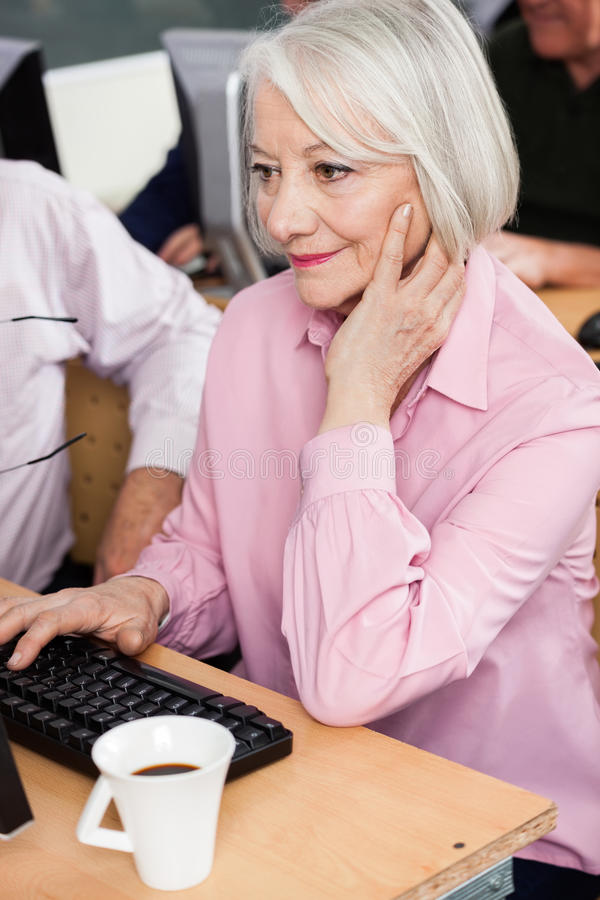 Senior Student Using Desktop PC royalty free stock photography