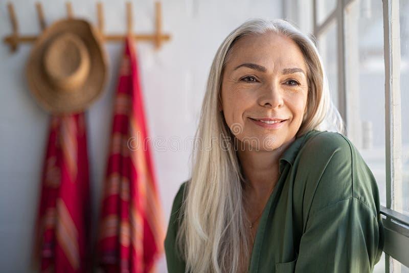 Senior stylish woman thinking royalty free stock image
