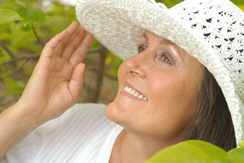 Senior in a summer hat stock images