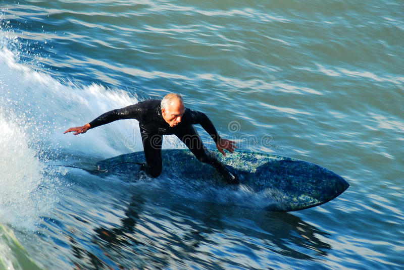 Senior Surfing stock image