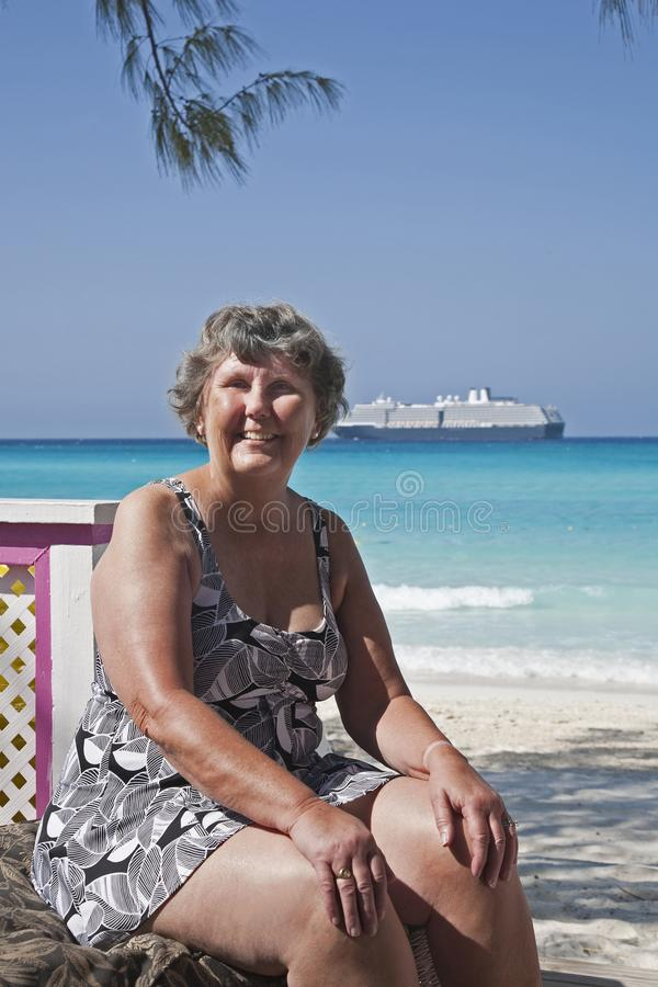 Senior in swimsuit by the beach stock photography