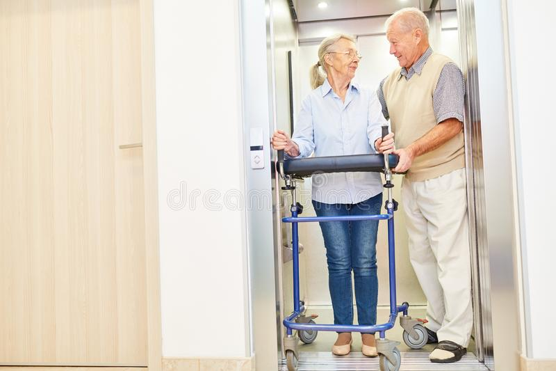 Senior takes care of disabled woman royalty free stock photos