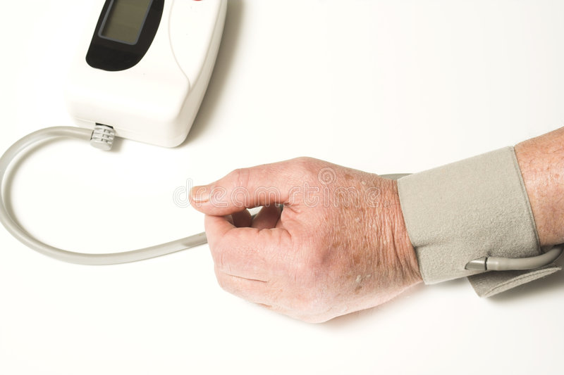 Senior taking blood pressure stock photography