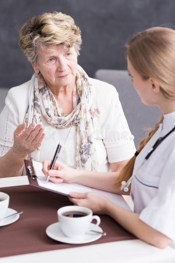Senior talking about her ailments royalty free stock photo