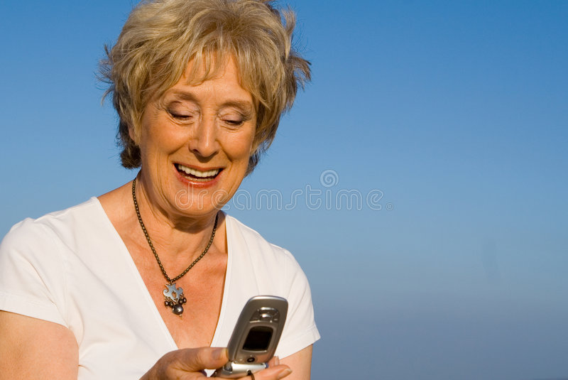 Senior text message,mobile cell phone stock images