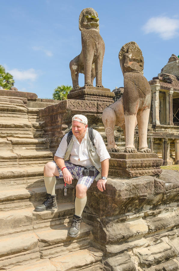 Senior tourist in Angkor Wat complex stock photography
