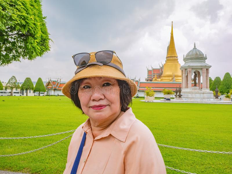 Senior Tourist in Wat Phrakeaw Temple with Cloud sky. Wat Phrakeaw Temple is the main Temple of bangkok Capital of Thailand stock images