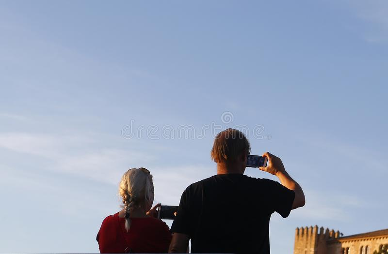 Senior tourists taking photographs in mallorca streets stock image