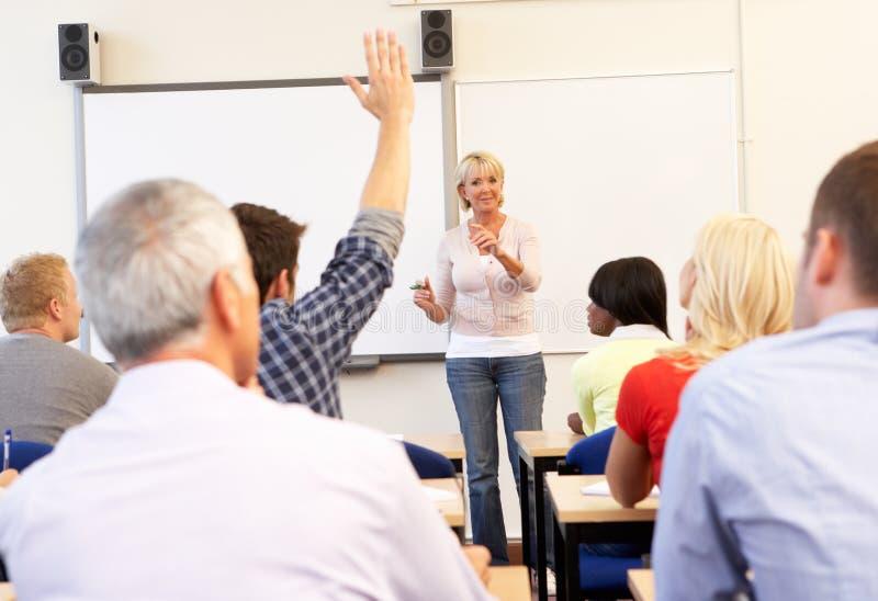 Senior tutor teaching class stock photography
