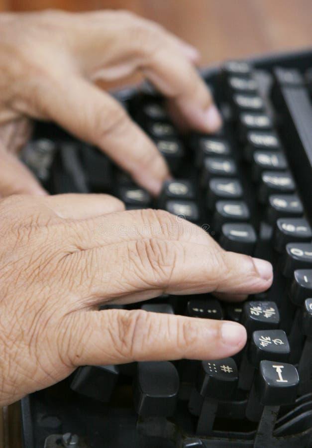 Senior typing royalty free stock photo