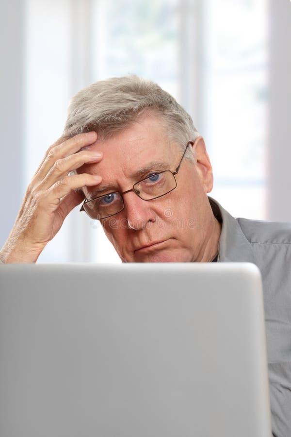 Senior using laptop stock image