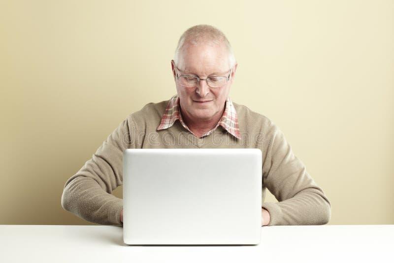 Senior Using Laptop Stock Photography