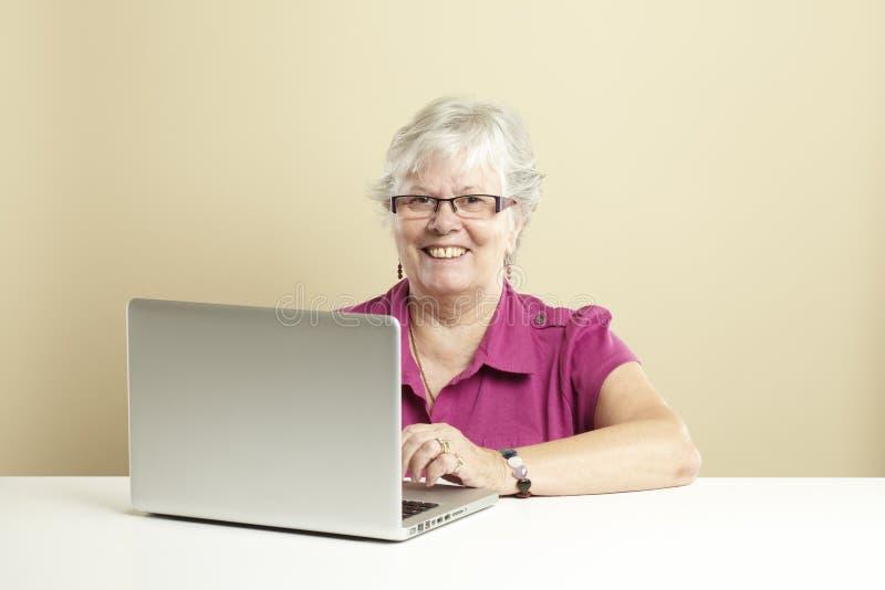 Download Senior using laptop stock image. Image of horizontal - 25892245