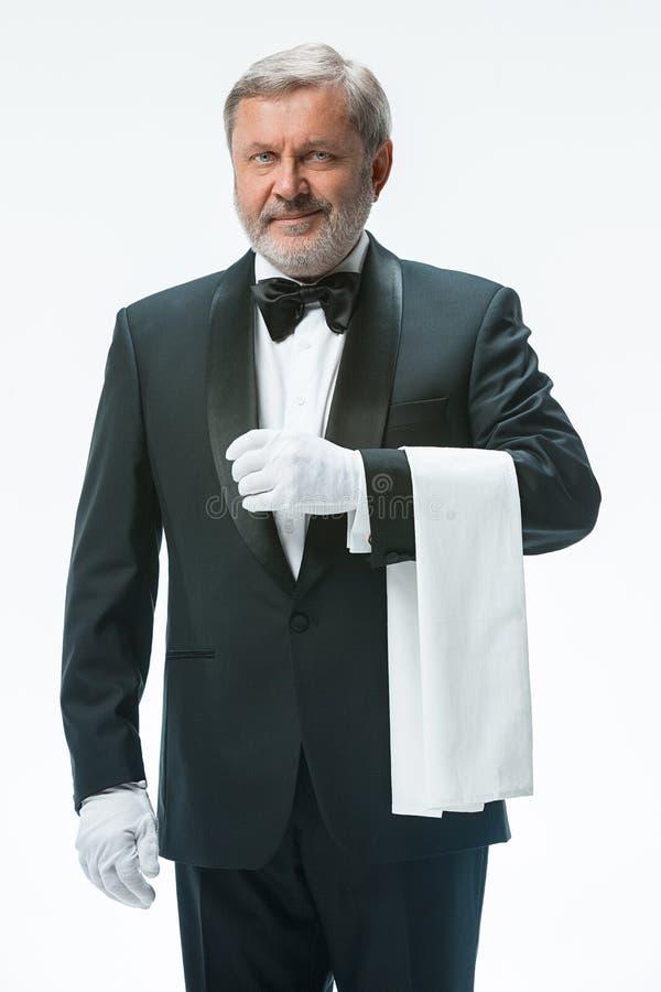 Senior waiter holding white towel stock photos