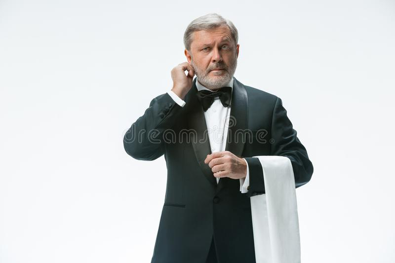 Senior waiter with white towel. Sign language in the restaurant royalty free stock photos