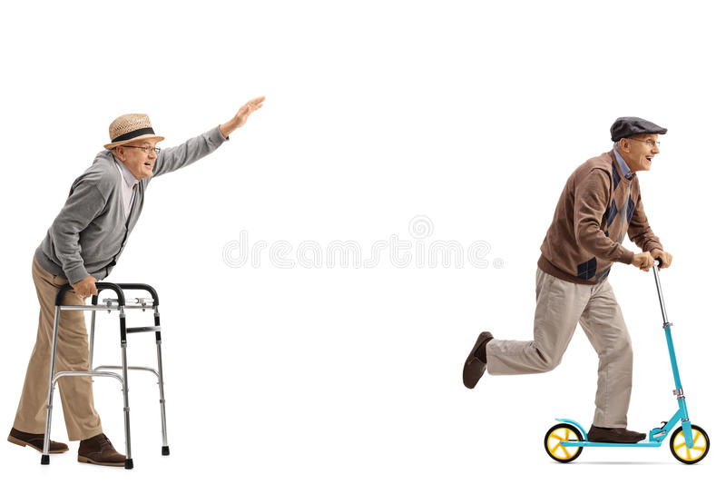 Senior with a walker trying to keep up with a senior with a scoo stock photography
