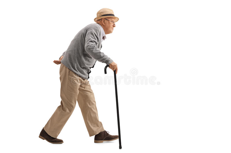 Senior walking with a cane. Full length profile shot of a senior walking with a cane isolated on white background royalty free stock images