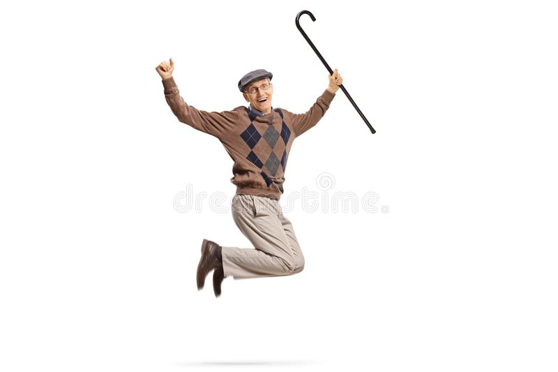Senior with a walking cane jumping and gesturing happiness. Isolated on white background royalty free stock image