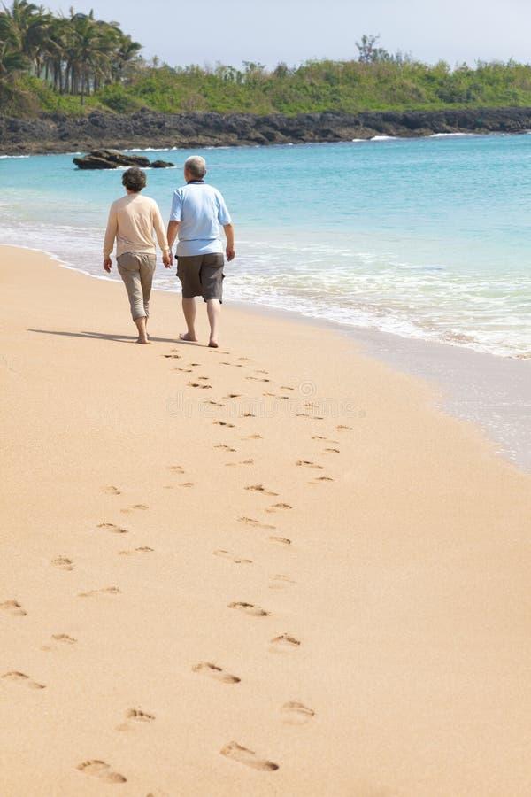 Free Senior Walking On The Beach With Footprint Royalty Free Stock Photos - 34285818