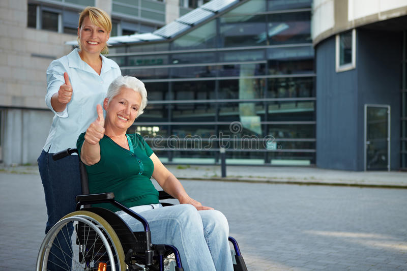 Senior wheelchair driver holding royalty free stock images
