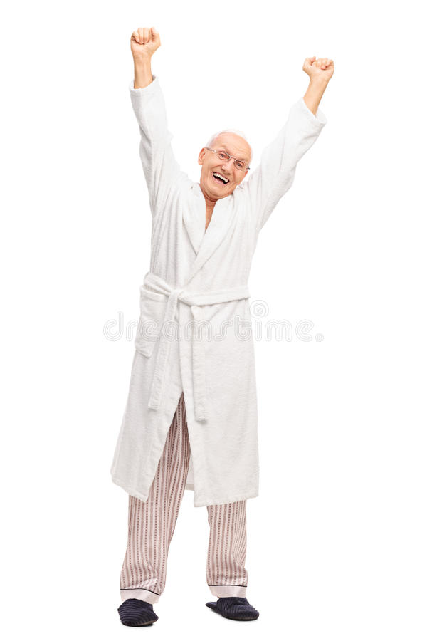 Senior in a white bathrobe stretching himself stock photography