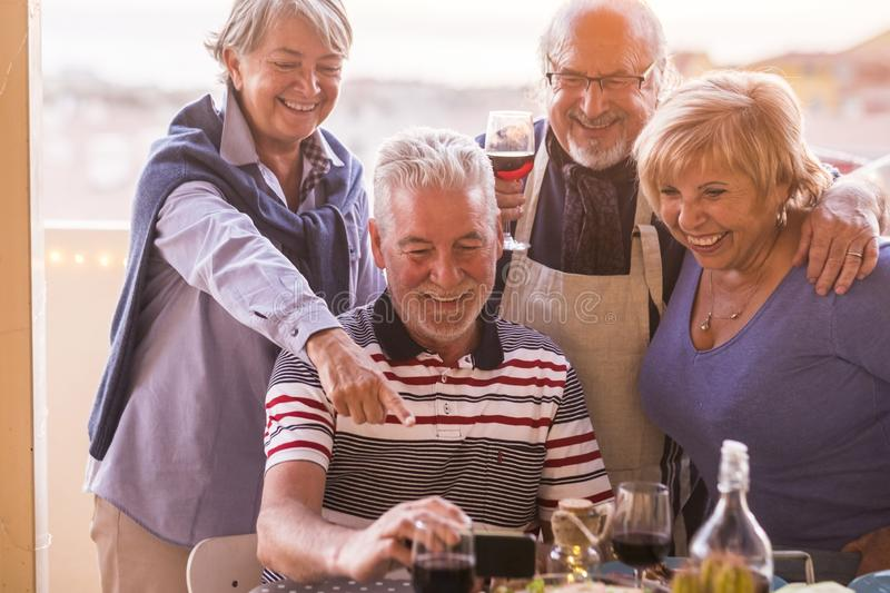 Group of seniors having fun together outdoor stock images