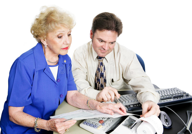 Senior Woiman Consults Accountant. Senior women consulting accountant about her taxes and financial planning. White background royalty free stock images