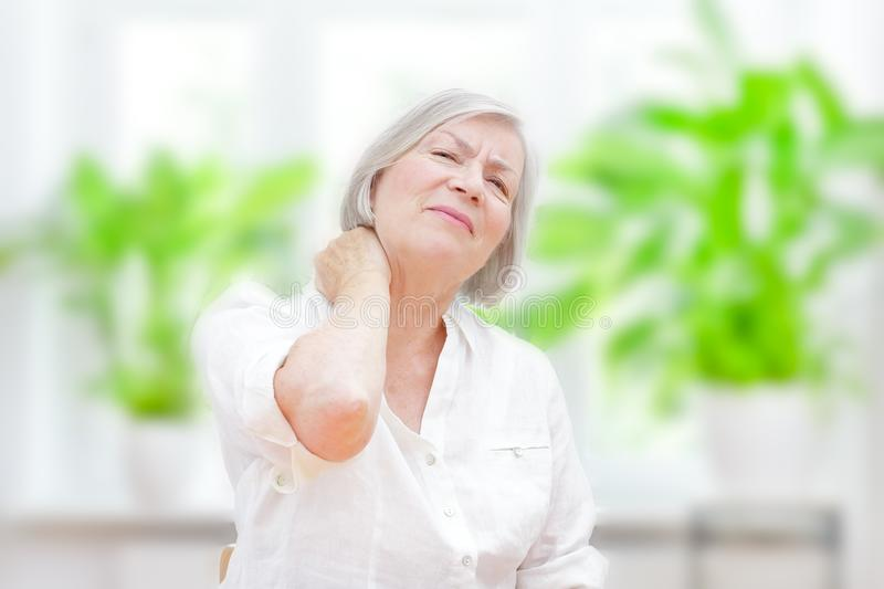Senior woman acute neck pain stock photo