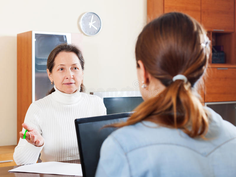 Senior woman answer questions of social worker royalty free stock images