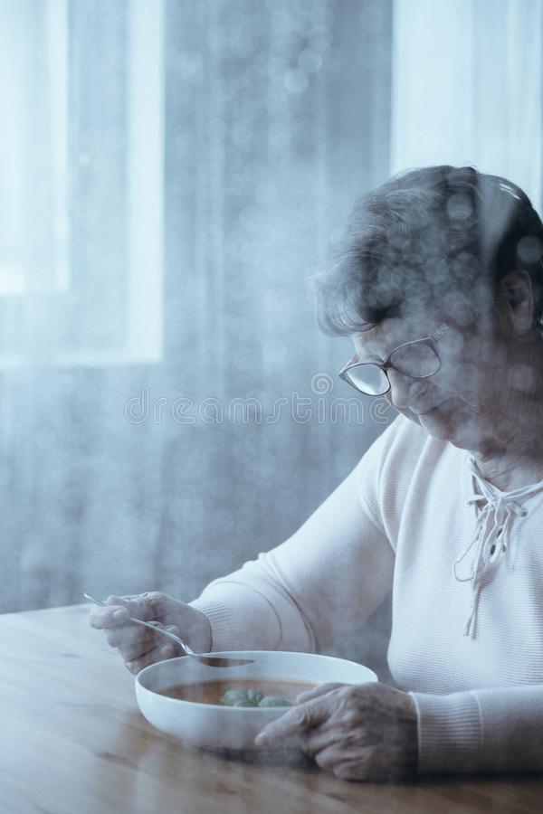 Senior woman with appetite problem royalty free stock photography