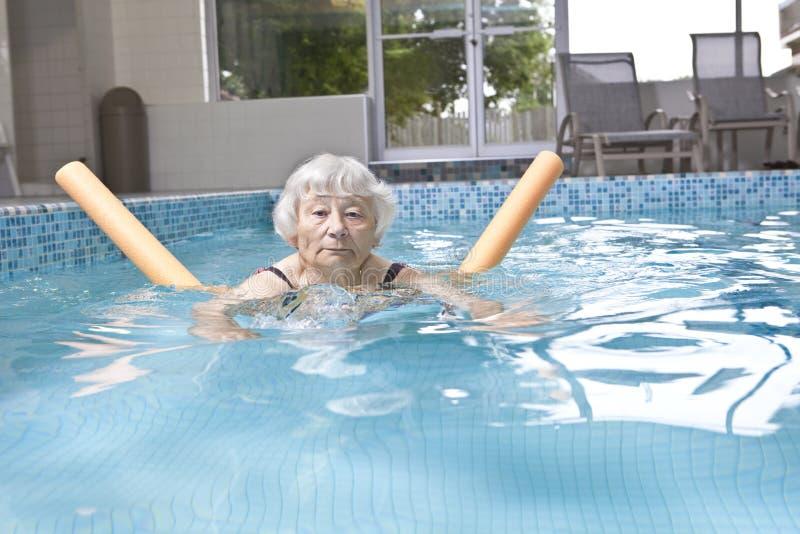Senior woman aqua fitness stock photography