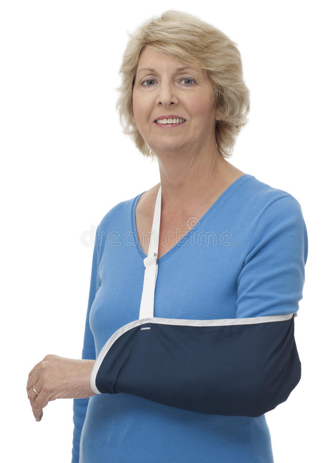 Senior woman with arm in sling royalty free stock photography