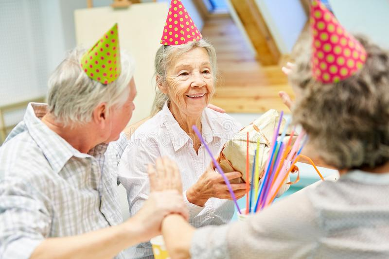 Senior woman as a birthday girl is happy stock photography