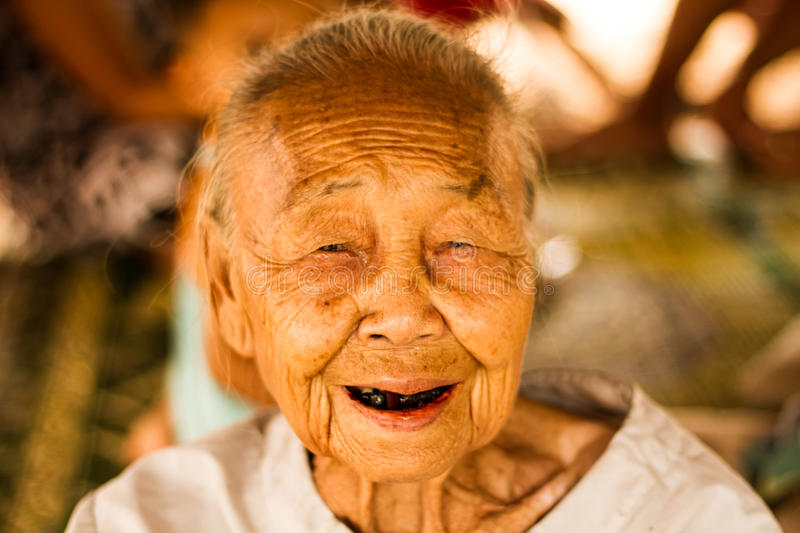Senior woman. Senior asian woman smiling with black teeth stock photo
