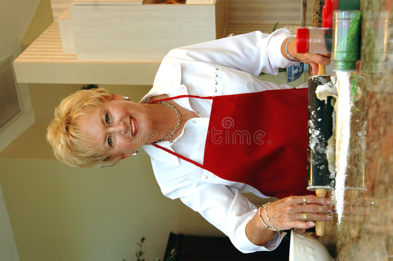 Download Senior woman baking stock photo. Image of apron, measure - 1417926