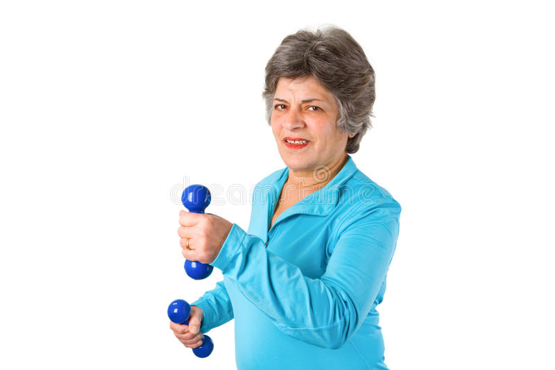Senior woman with barbells royalty free stock image