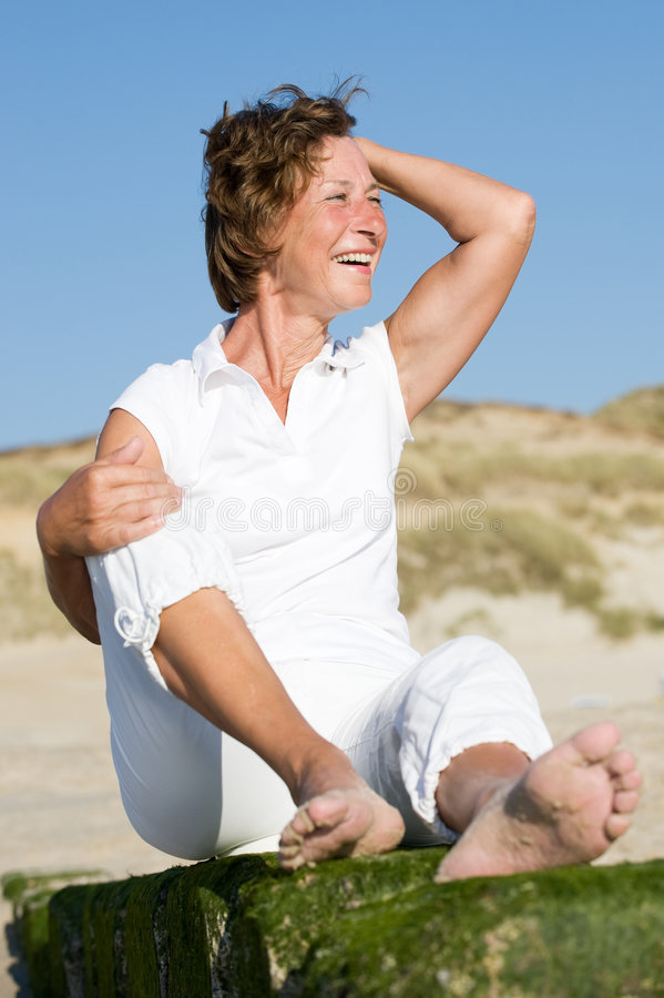 Senior woman at the beach stock images