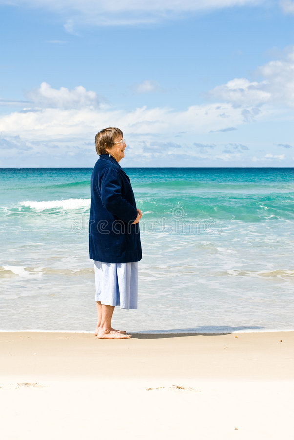 Senior Woman at Beach royalty free stock photography