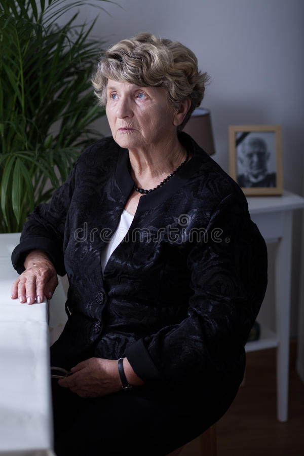 Senior woman in black clothes royalty free stock photography