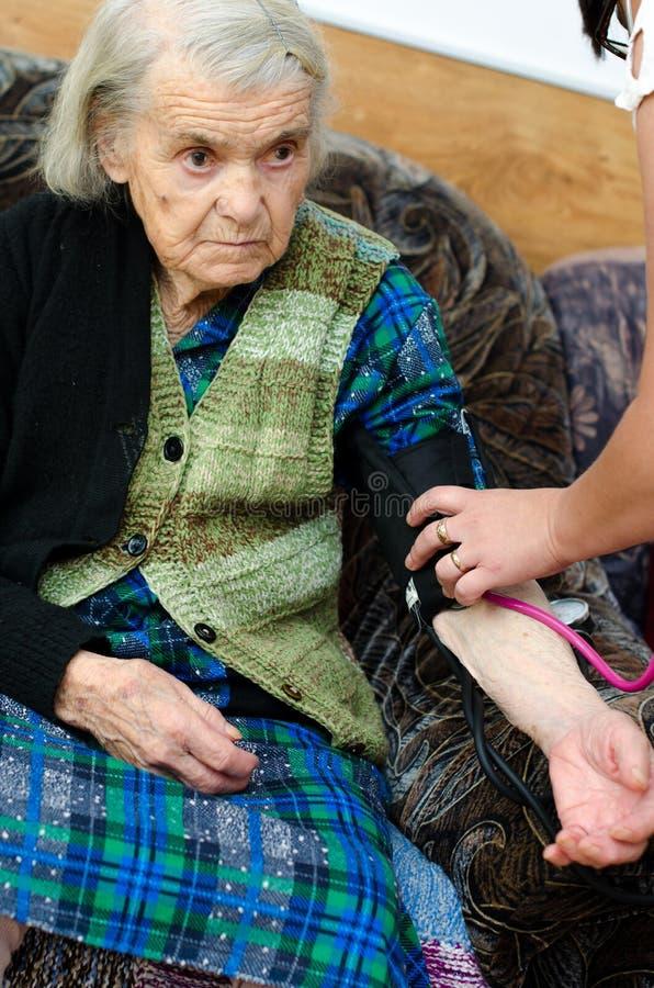 Senior woman blood pressure royalty free stock photos