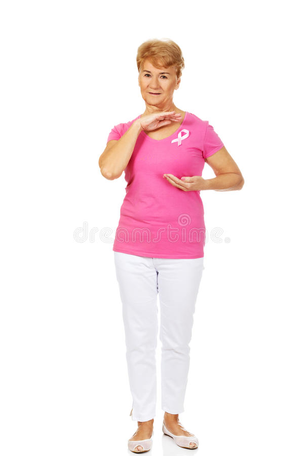 Senior woman with breast cancer awareness ribbon.  stock images