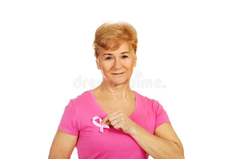 Senior woman with breast cancer awareness ribbon stock photography