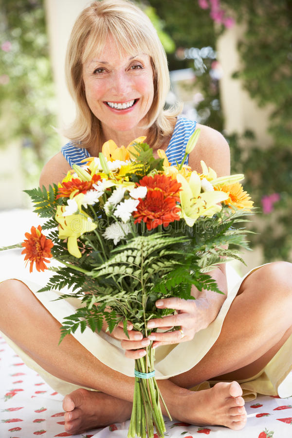 Download Senior Woman With Bunch Of Flowers Stock Photo - Image: 27274138