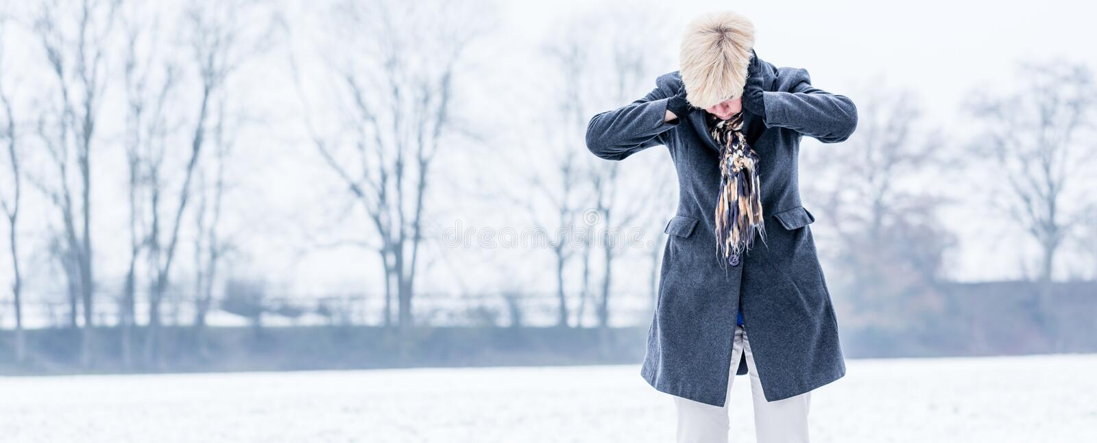 Senior woman with burnout in winter stock photography