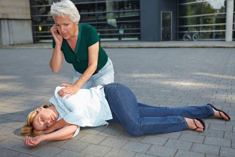 Senior woman calling ambulance royalty free stock image