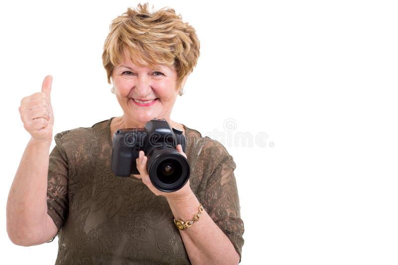Senior woman camera thumb up royalty free stock images