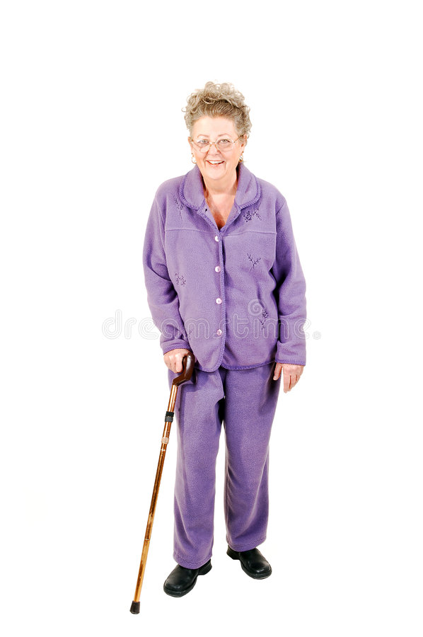 Senior woman with cane. Senior woman with gray hair and an lilac suit needs the help of a cane to get around. On white background royalty free stock image