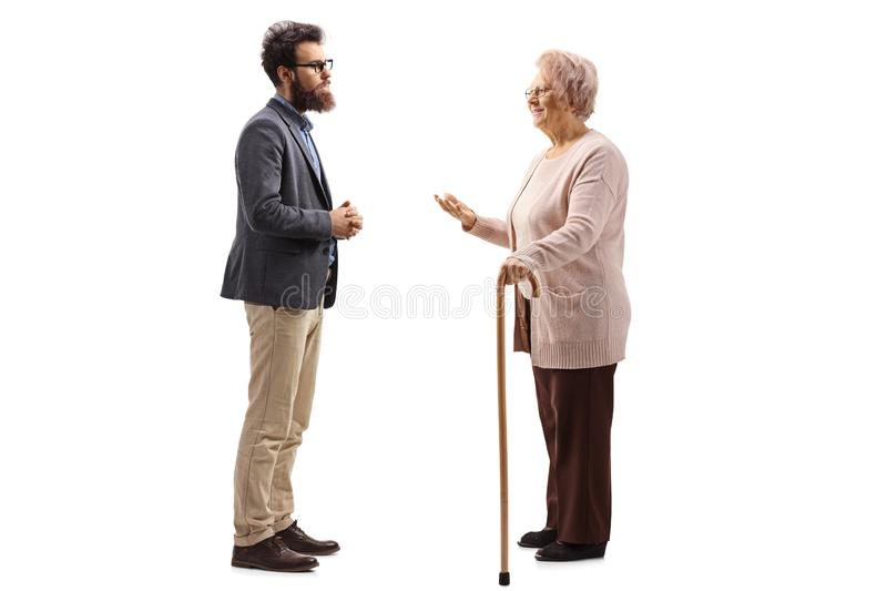 Senior woman with a cane talking to a bearded man royalty free stock images