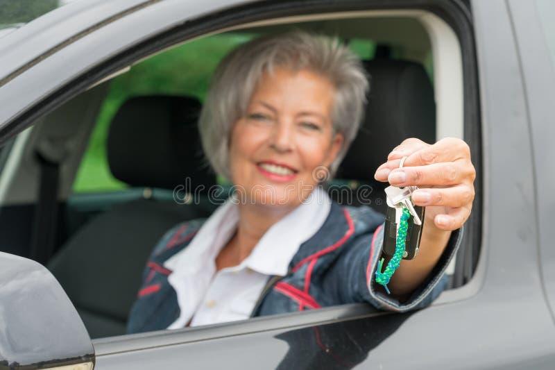 Senior woman in car stock photography