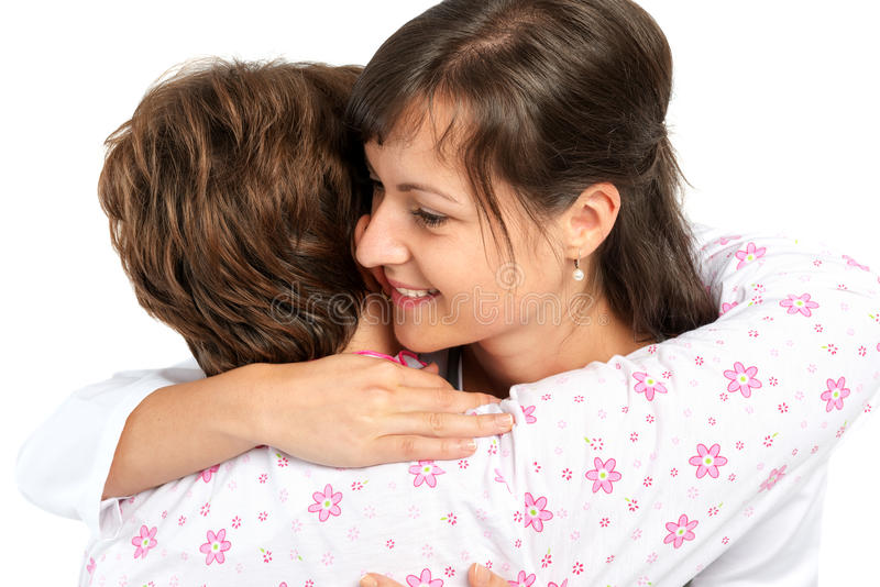 A senior woman and caregiver hugging. A senior women and caregiver hugging isolated stock image